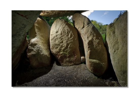 The structural stones lean heavily under the enormous weight of the capstone.